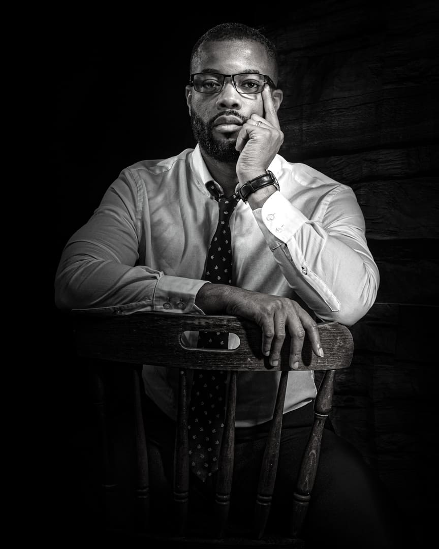 """""""Powerful Photography"""" Black & White Corporate Portrait of a modern take of the classic Malcolm X Pose. https""""//powerfulphotography.co.uk"""